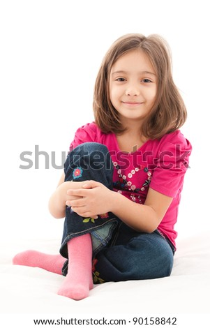 portrait of a lovely little girl, smiling, isolated on white background - stock photo