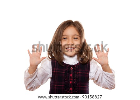 portrait of a lovely little girl, smiling, showing ten items, dressed in school uniform, isolated on white background