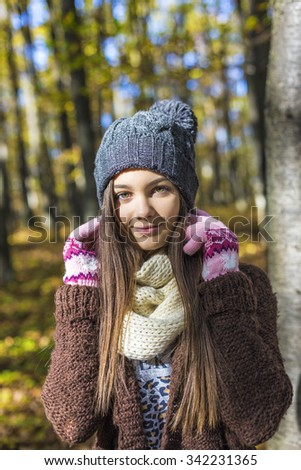 Portrait of a lovely teenage girl in the forest - stock photo