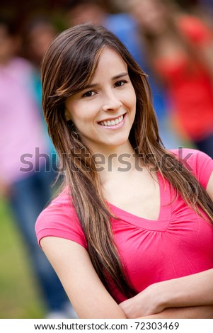 Portrait of a lovely woman smiling outdoors - stock photo