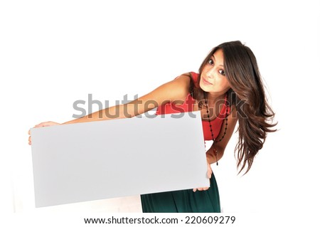 Portrait of a lovely young female holding blank sheet against white background