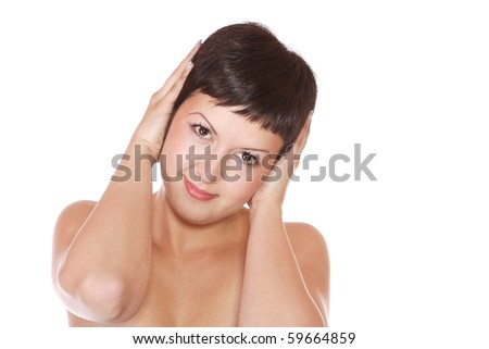 Portrait of a lovely young female standing against white background