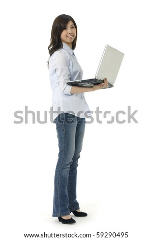 Portrait of a lovely young female using laptop against white background - stock photo