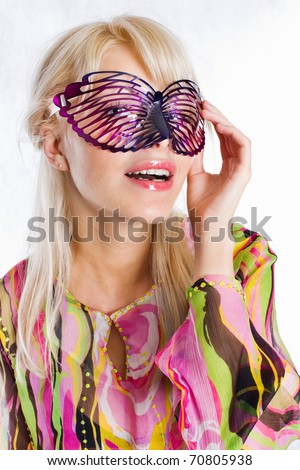 Portrait of a lovely young female wearing a party mask - stock photo