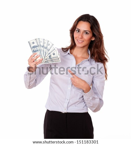 Portrait of a lovely young woman holding cash dollars on isolated background
