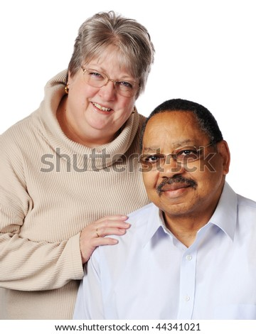 Portrait of a loving biracial senior couple.  Isolated on white.