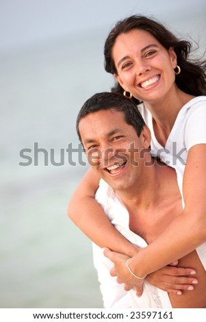Portrait of a loving couple enjoying their vacations on the beach