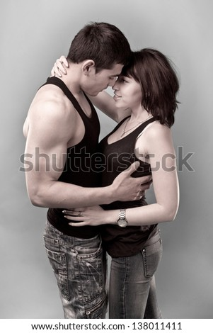 portrait of a loving couple on the gray background - stock photo
