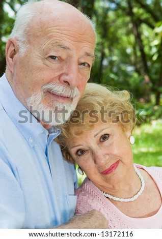 Portrait of a loving, devoted senior couple outdoors.