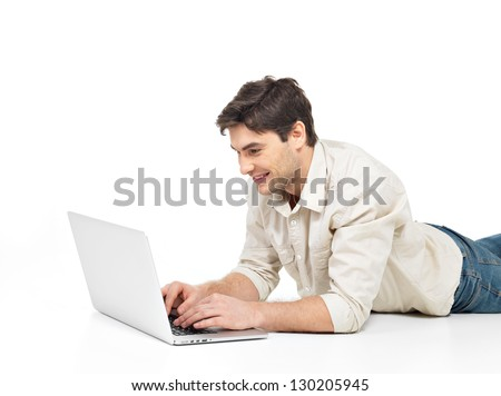 Portrait of a lying successful happy man with laptop watch on screen  isolated on white. Concept communication.