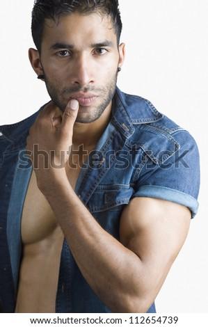 Portrait of a macho man - stock photo