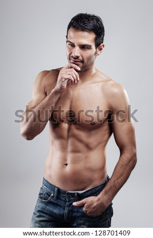 Portrait of a macho man - stock photo
