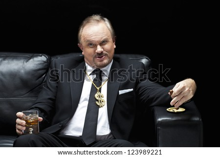 Portrait of a mafia boss with a cigar and a glass of whiskey