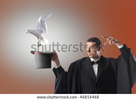 Portrait of a magician letting a dove flying out of his hat - stock photo