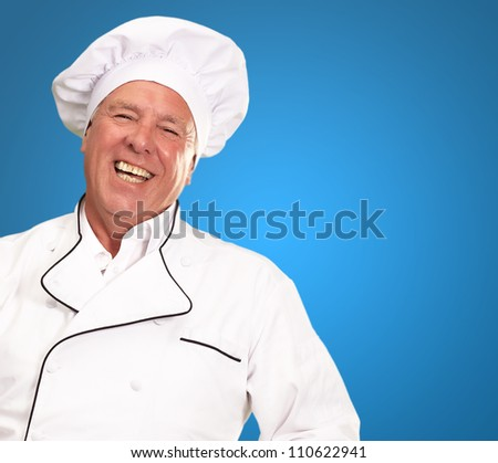 Portrait Of A Male Chef On A Blue Background