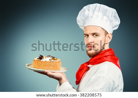 Portrait of a male confectioner cooking a delicious cake.  - stock photo