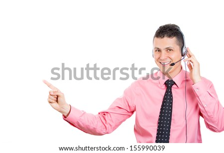 Portrait of a male customer service representative or call center agent, support operator with headset, isolated on white background, pointing at a copy space. Businesspeople, corporate life, career  - stock photo