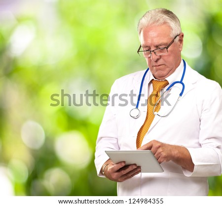 Portrait Of A Male Doctor Holding A Tab, Outdoor - stock photo