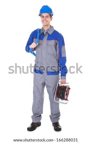 Portrait Of A Male Happy Electrician Holding Cords - stock photo