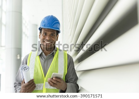 Portrait of a male Indian builder or industrial engineer at work. - stock photo