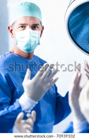 Portrait of a male surgeon at work - stock photo