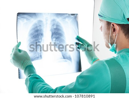 Portrait of a male surgeon examining a radiography - stock photo