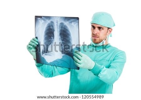 Portrait of a male surgeon examining a radiography. Isolated on white - stock photo