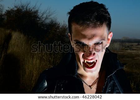 Portrait of a male vampire - stock photo