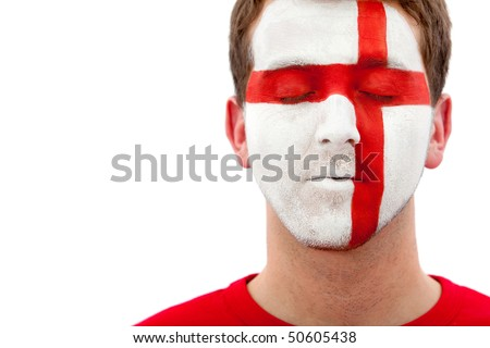 Portrait of a male with a british flag painted on his face - stock photo