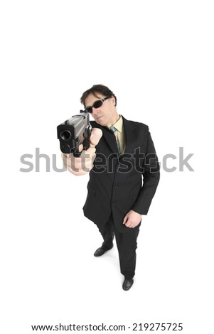 Portrait of a man aiming with gun over white background - stock photo