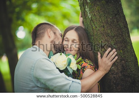 portrait of a man and woman with flowers in nature .