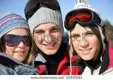 Portrait of a man and women in snowsuit - stock photo