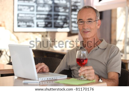 portrait of a man at a terrace - stock photo