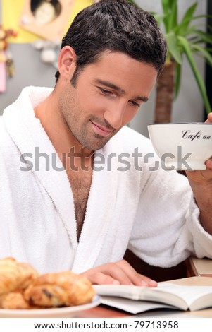 portrait of a man at breakfast - stock photo