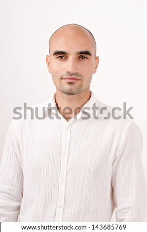Portrait of a man. Bald man dressed in white. - stock photo