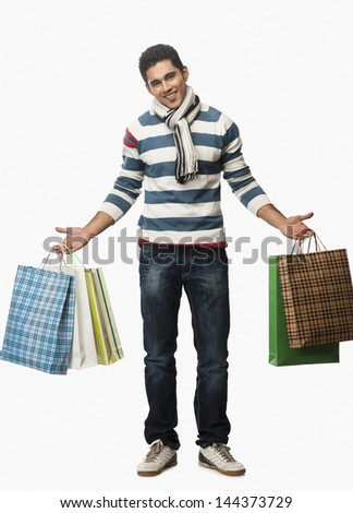 Portrait of a man carrying shopping bags