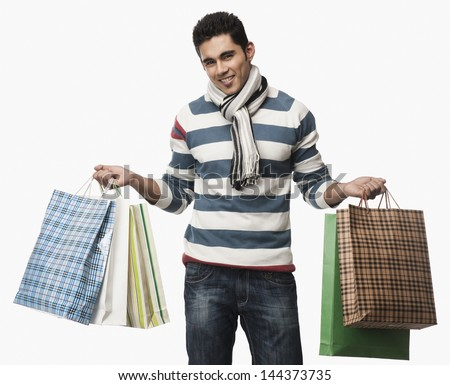 Portrait of a man carrying shopping bags - stock photo