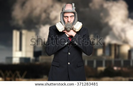 Portrait of a man choking in a polluted city - stock photo