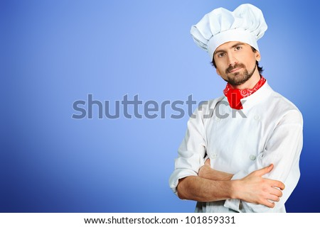 Portrait of a man cook posing  in a studio. - stock photo