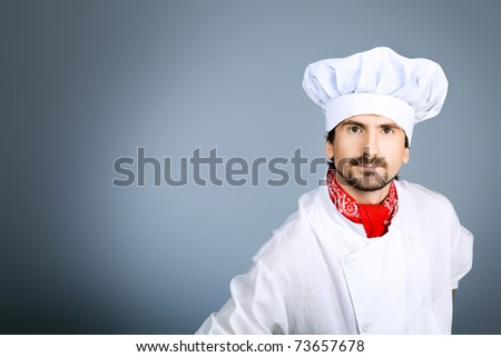 Portrait of a man cook. Shot in a studio over grey background. - stock photo