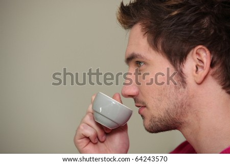 Portrait of a man drinking coffee - stock photo