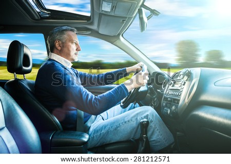 Portrait of a man driving his SUV - stock photo