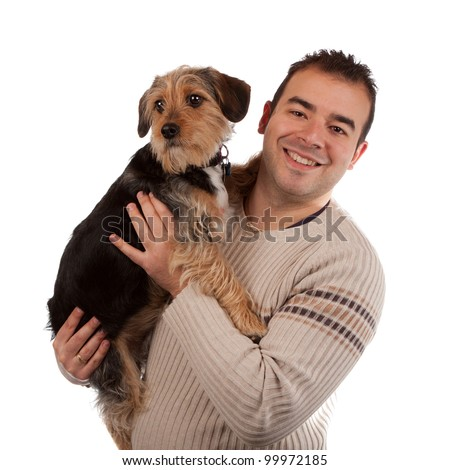 Portrait of a man holding a cute mixed breed dog isolated over white. - stock photo