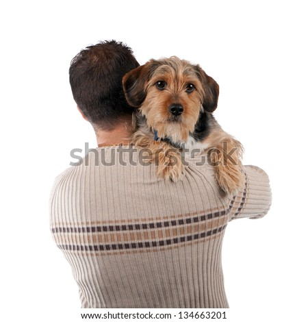 Portrait of a man holding a cute mixed breed dog over his shoulder isolated over white. - stock photo