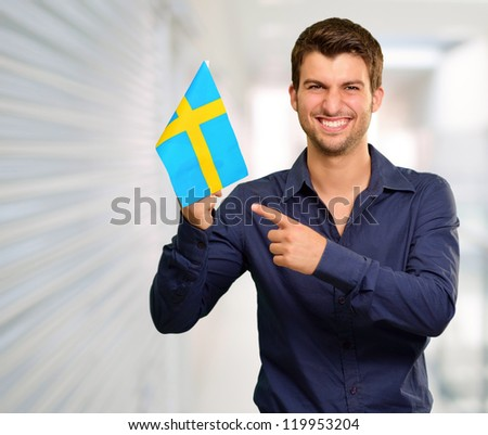 Portrait of a man holding flag, indoor