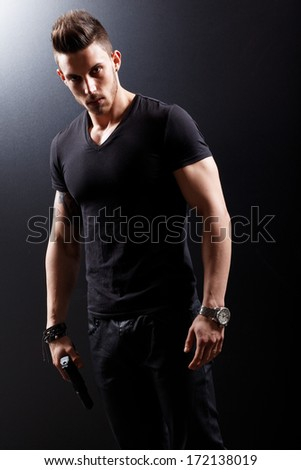 Portrait Of A Man Holding Gun  - stock photo