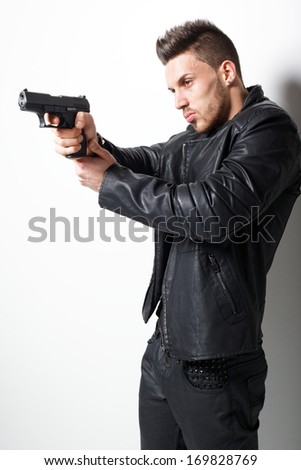 Portrait Of A Man Holding Gun. Fashion photo. - stock photo