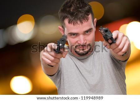 Portrait Of A Man Holding Gun, outdoor - stock photo