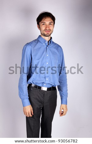 portrait of a man in a blue shirt in studio - stock photo
