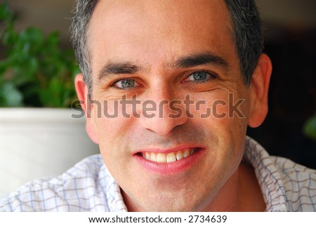Portrait of a man in a cafe - stock photo